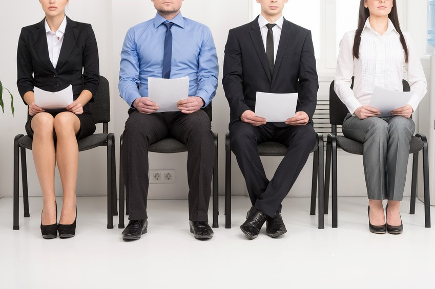 Trainee estate agents queuing for an interview